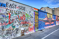 """The East Side Gallery is an international memorial for freedom. It is a 1.3 km long section of the Berlin Wall located near the centre of Berlin on Mühlenstraße in Friedrichshain-Kreuzberg. The actual border at this point was the river Spree. The gallery is located on the so-called """"hinterland mauer"""", which closed the border to East Berlin and it consists of 105 paintings by artists from all over the world, painted in 1990 on the east side of the Berlin Wall."""
