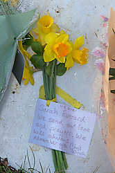 © Licensed to London News Pictures 12/03/2021. Ashford, UK. Flower and message at the main gate. Teams of Metropolitan police officers continue to search Great Chart Leisure in Ashford, Kent today in connection with the ongoing investigation into the disappearance of Sarah Everard from London. Photo credit:Grant Falvey/LNP