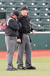 16 May 2014:  Plate Umpire David Fields and Field Umpire Dennis George during a Frontier League Baseball game between the Evansville Otters and the Normal CornBelters at Corn Crib Stadium on the campus of Heartland Community College in Normal Illinois