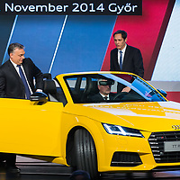 Viktor Orban (L) prime minister of Hungary gets into the first Audi TT Roadster introduced during the official production launch event in the Audi factory in Gyor (about 120 km West of Budapest), Hungary on November 05, 2014. ATTILA VOLGYI