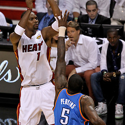 Jun 21, 2012; Miami, FL, USA; Miami Heat power forward Chris Bosh (1) shoots over Oklahoma City Thunder center Kendrick Perkins (5) during the first quarter in game five in the 2012 NBA Finals at the American Airlines Arena. Mandatory Credit: Derick E. Hingle-US PRESSWIRE