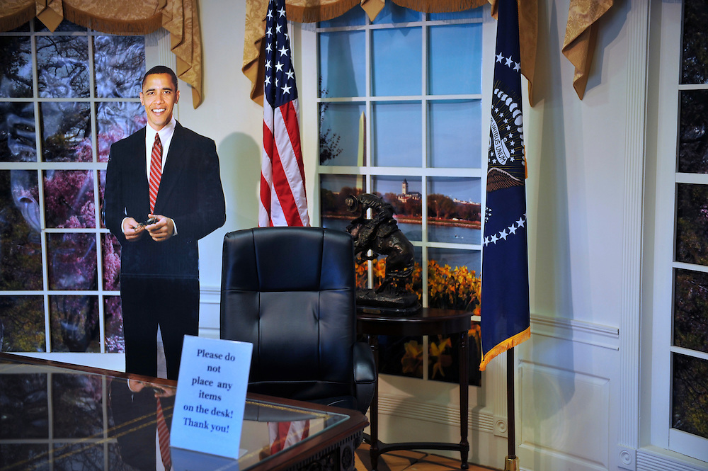 A cardboard cut out of President-elect Obama in the oval office greets pedestrians from a window display in a Washington D.C. souvenir store.  The Presidential Inauguration takes place January 20th, 2009, swearing in Obama as the nation's 44th president.