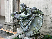 Statue of a woman riding a turtle on a wave, in front of Hilo's Tsunami Museum, which was established in 1997 inside the 1930 First Hawaiian Bank building. The movie room is in the old bank vault. Hilo is on the Big Island of Hawaii, USA.