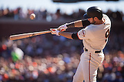 San Francisco Giants first baseman Brandon Belt (9) pops a foul ball against the Los Angeles Dodgers at AT&T Park in San Francisco, Calif., on October 1, 2016. (Stan Olszewski/Special to S.F. Examiner)