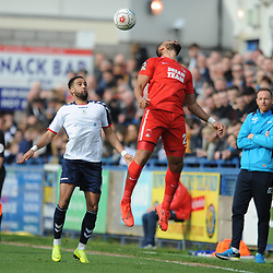 TELFORD COPYRIGHT MIKE SHERIDAN 23/3/2019 - Jamie Turley of Orient flicks on under pressure from Brendon Daniels of AFC Telford during the FA Trophy Semi Final fixture between AFC Telford United and Leyton Orient at the New Bucks Head