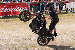 Cole Freeman of the Ill Conduct Stunt Team performs for the crowd at Sopotnicks Cabbage Patch Bar, New Smyrna Beach, during Daytona Bike Week's 75th Anniversary event. FL, USA. Saturday March 12, 2016.  Photography ©2016 Michael Lichter.