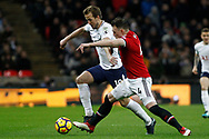 Harry Kane of Tottenham Hotspur (L) in action with Phil Jones of Manchester United (R). Premier league match, Tottenham Hotspur v Manchester Utd at Wembley Stadium in London on Wednesday 31st January 2018.<br /> pic by Steffan Bowen, Andrew Orchard sports photography.