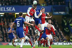 10 January 2018 - Football League Cup - Chelsea v Arsenal - Danny Welbeck of Arsenal wins a header over Marcos Alonso of Chelsea and Rob Holding of Arsenal - Photo: Charlotte Wilson / Offside