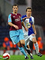 Fotball<br /> Foto: SBI/Digitalsport<br /> NORWAY ONLY<br /> <br /> Blackburn Rovers v West Ham United. The Barclays Premiership. 17/03/2007.<br /> West Ham's Lucas Neill (L) gets the better of Morten Gamst Pedersen