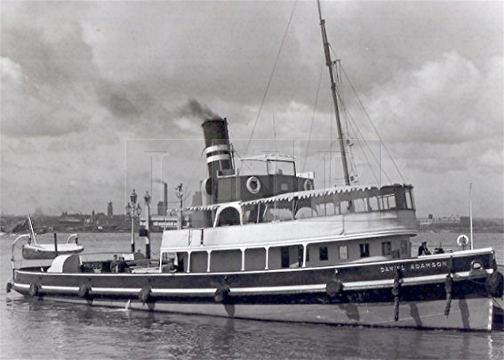 """© Licensed to London News Pictures. 30/09/2016. Birkenhead UK. Collect picture shows the Daniel Adamson in Liverpool's Pier Head in 1947. The Daniel Adamson steam boat has been bought back to operational service after a £5M restoration. The coal fired steam tug is the last surviving steam powered tug built on the Mersey and is believed to be the oldest operational Mersey built ship in the world. The """"Danny"""" (originally named the Ralph Brocklebank) was built at Camel Laird ship yard in Birkenhead & launched in 1903. She worked the canal's & carried passengers across the Mersey & during WW1 had a stint working for the Royal Navy in Liverpool. The """"Danny"""" was refitted in the 30's in an art deco style. Withdrawn from service in 1984 by 2014 she was due for scrapping until Mersey tug skipper Dan Cross bought her for £1 and the campaign to save her was underway. Photo credit: Andrew McCaren/LNP"""