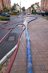 Pipes of a high volume pump (HVP) drain away flood water after torrential rain caused flooding in Oxford and the Thames Valley area; July 2007,