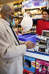 Man being served at his local shop; East Midlands Supermarket; Nottingham,