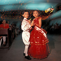 Philippines, Luzon Island, (MR) Jean Paola Yu, 9 dances with young escort at Ms. Valentine beauty pageant in Legazpi