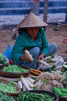 Woman selling fresh green veges in Hoi An street market.