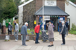 © Licensed to London News Pictures 06/05/2021. Bromley, UK. Local residents go to vote at Hayes Village Hall in Bromley, London. Local council Elections 2021. Polling stations have opened across the UK today to allow people to vote for their Local councillors, police and crime commissioners and Londoners will get to elect the next Mayor of London. Due to Coronavirus people have to wear masks when voting. Photo credit:Grant Falvey/LNP
