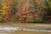 Autumn color lines the banks of the Cuyahoga River as it flows through Cuyahoga Valley National Park in Ohio.