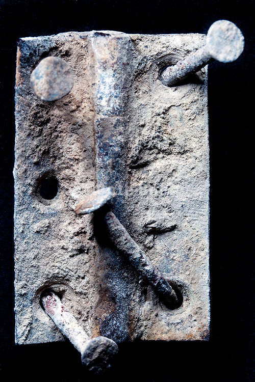 burned hinge with ash and bended rusty nails