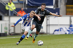 (L-R) Martin Odegaard of sc Heerenveen, Nick Viergever of Ajax during the Dutch Eredivisie match between sc Heerenveen and Ajax Amsterdam at Abe Lenstra Stadium on October 01, 2017 in Heerenveen, The Netherlands