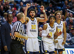 Jan 21, 2019; Morgantown, WV, USA; West Virginia Mountaineers guard Jermaine Haley (10) and players celebrate from the bench during the second half against the Baylor Bears at WVU Coliseum. Mandatory Credit: Ben Queen-USA TODAY Sports
