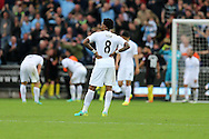 Swansea city players inc Leroy Fer © look dejected after they concede the 3rd Manchester city goal. Premier league match, Swansea city v Manchester city at the Liberty Stadium in Swansea, South Wales on Saturday 24th September 2016.<br /> pic by Andrew Orchard, Andrew Orchard sports photography.