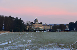 © Licensed to London News Pictures. 16/02/2016. Castle Howard, UK. The sky turns pink before the sun rises at Castle Howard, North Yorkshire. Photo credit : Anna Gowthorpe/LNP