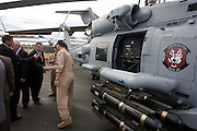 US Navy pilots show guests around their Sikorsky MH-60R helicopter with Hellfire missiles at the Farnborough Airshow. ..The MH-60R is the U.S. Navy's newest and most advanced multi-mission helicopter, designed for anti-submarine and surface warfare (ASW/ASuW). Secondary missions include: Search and Rescue, anti-ship surveillance and targeting, communication relay and medevac/vertical replenishment. The Sikorsky-built helicipter with integrated avionics and mission systems by Lockheed Martin.
