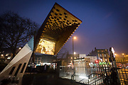 Photographic projections of the victims of the Bethnal Green tube disaster are projected onto the Stairway to Heaven memorial next to the Bethanal Green Tube station entrance in London, England, on March 3rd, 2018 to mark the 75th anniversary of the Bethnal Green World War 2 tube disaster on 3rd March 1943.  On the night of the disaster a crowd of people were waiting to enter the underground air raid shelter when the deafening sound of a new anti-aircraft rocket was fired for the first time from Victoria Park. A woman with a child fell and others tumbled over her and within seconds the whole staircase was a tangled mass of 300 trapped people. 73 people died including 84 women, 62 children and 27 men.