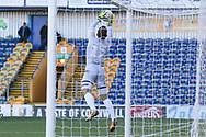 Robert Olejnik of Mansfield Town (12) catches the ball under the cross bar during the The FA Cup match between Mansfield Town and Charlton Athletic at the One Call Stadium, Mansfield, England on 11 November 2018.