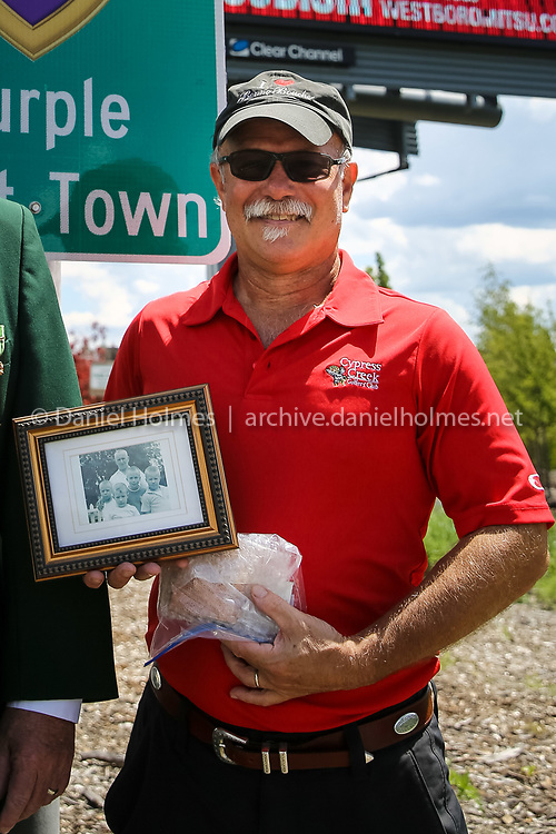 (8/7/16, WESTBOROUGH, MA) David Reese, of Westborough, brought his grandfather's (Stanley Szawczik) Purple Heart  from WWI during the unveiling of a new sign identifying Westborough as a Purple Heart Town along Rt. 9 in Westborough on Sunday. Daily News and Wicked Local Photo/Dan Holmes