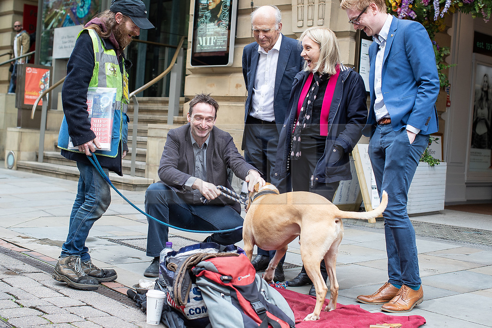 """© Licensed to London News Pictures. 20/06/2019. Manchester, UK. In one of his last actions as Liberal Democrat Party leader , SIR VINCE CABLE arrives to meet Big Issue seller JUSTIN GREEN (49) and his dog BUMPER (ten), in Manchester City Centre , alongside Cllr JOHN LEACH and JANE BROPHY MEP . The party say they are highlighting what they call a """" Homeless Tax """" , which they oppose , and which could see fines of up to £1,000 imposed upon the homeless by Manchester City Council . The final Local Government Information Unit (LGiU) report from the Local Government Homelessness Commission (LGHC) – a year-long initiative set up to investigate how councils can fulfil their obligation to prevent homelessness - is due to be published . The Liberal Democrats will appoint a new leader in July . Photo credit: Joel Goodman/LNP"""