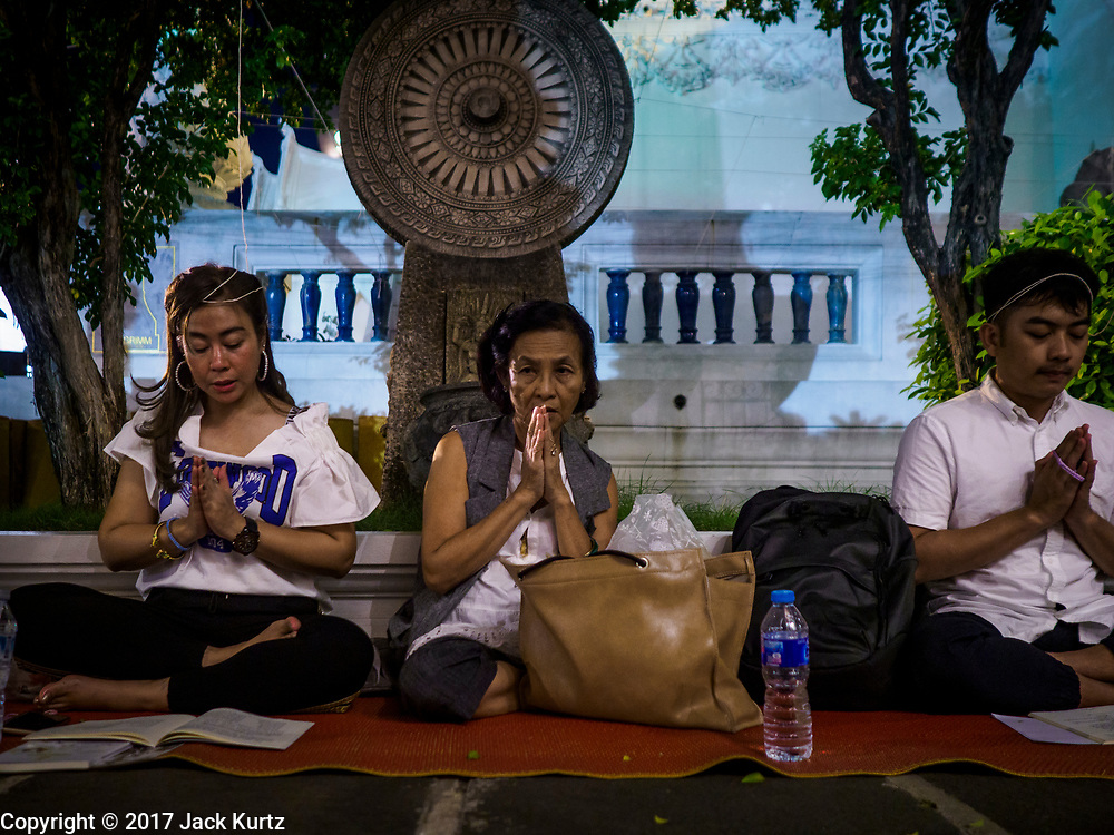 31 DECEMBER 2017 - BANGKOK, THAILAND:  People pray in front of a mandala on New Year's Eve at Wat Pathum Wanaram in central Bangkok. Many Thais go to temples and shrines to pray and meditate during New Year's Eve and New Year's Day.   PHOTO BY JACK KURTZ