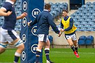 Adam Hastings (#10) (Glasgow Warriors) of Scotland is all smiles as he runs with the ball during the Scotland Team Run at BT Murrayfield, Edinburgh, Scotland on 22 October 2020, ahead of Scotland v Georgia.