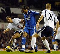 Photo: Ed Godden.<br /> Tottenham Hotspur v Chelsea. The Barclays Premiership. 05/11/2006. Chelsea's Didier Drogba (C) makes his way past Jermaine Jenas (L) and Michael Dawson (R).