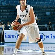 Efes Pilsen's Cenk AKYOL during their Turkish Basketball league match Efes Pilsen between Bornova Belediyespor at the Sinan Erdem Arena in Istanbul Turkey on Saturday 16 April 2011. Photo by TURKPIX
