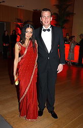 AKHEE RAHMAN and WERNER MUERZ at Andy & Patti Wong's Chinese New Year party to celebrate the year of the Rooster held at the Great Eastern Hotel, Liverpool Street, London on 29th January 2005.  Guests were invited to dress in 1920's Shanghai fashion.<br /><br />NON EXCLUSIVE - WORLD RIGHTS