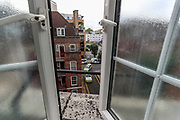 A view from a bathroom window shows multiple police cars rushing into a neighbourhood in south London by Tower Bridge on Tuesday, Aug 18, 2020 - after a man was reported to allegedly have assaulted members of the public and an emergency worker. The suspected didn't respond to multiple calls by the police to surrender. Police stormed into his barricaded doorstep and couldn't find him. The search is on-going. (VXP Photo/ Vudi Xhymshiti)