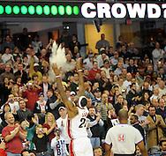 LeBron James throws talcum powder in the air during his pregame ritual.