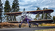 Civilianized Stearman taxiing at Hood River Fly In at Western Antique Aeroplane and Automobile Museum