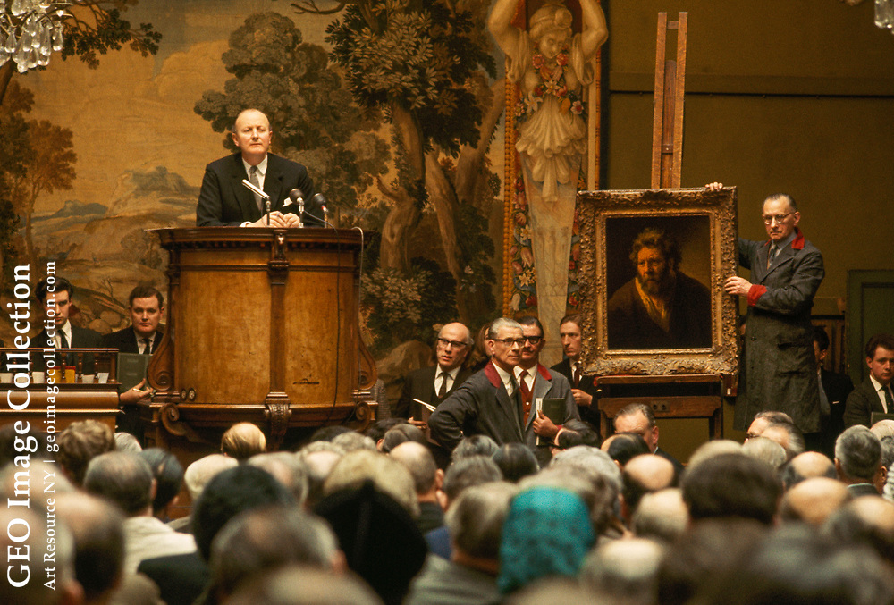 Auction crowd at Sotheby's bids on a Rembrandt painting.