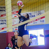 St Michaels Cardinal Delila Nakaidinae (12) jumps for a shot at the Ganado Hornets during the championship of the Rehoboth Tournament Saturday at Rehoboth High School.