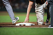 San Francisco Giants right fielder Hunter Pence (8) dives back to first base during a pick off attempt by the Oakland Athletics at AT&T Park in San Francisco, California, on March 26, 2018. (Stan Olszewski/Special to S.F. Examiner)