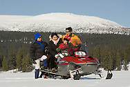 Group of outdoor enthusiasts snowmobile in the Yukon<br /> <br /> NOT IN YOUR BUDGET? Contact Cathie for a price specific to your project.