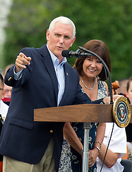 United States Vice President Mike Pence and his wife Karen, introduce US President Donald J. Trump and first lady Melania Trump as they host the annual Congressional Picnic on the South Lawn of the White House in Washington, DC, USA, on Thursday, June 22, 2017. Photo by Ron Sachs/CNP/ABACAPRESS.COM