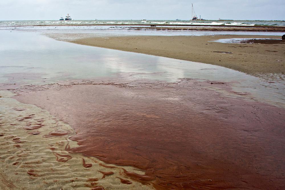 Pools of oil washed ashore at Barataria Pass, Grand Isle, LA on June 5, 2010.