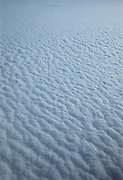 Looking down on pattern of clouds from above.