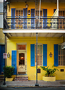 Typical building in the French Quarter area of New Orleans, Louisiana.  The French Quarter is the oldest and most famous and visited neighborhood of New Orleans. It was laid out in French and Spanish colonial times in the 18th century. While it has many hotels, restaurants, and businesses catering to visitors, it is best appreciated when you recall that it is still a functioning mixed-use residential/commercial neighborhood where locals live.