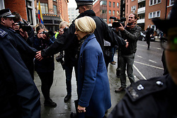 © Licensed to London News Pictures. 14/11/2016. London, UK. Swedish officials INGRID ISGREN (blonde hair) returns to the Ecuadorian Embassy in London following a lunch break in the questioning of WikiLeaks editor-in-chief, Julian Assange. Assange, who has been living at the embassy for over four years, is wanted for questioning over accusations of rape in Stockholm in 2010.  Photo credit: Ben Cawthra/LNP
