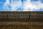 Two layers of razor wire fence protect the outer wall of Her Majesty's Prison Pentonville, London, United Kingdom. (Photo by Andy Aitchison)