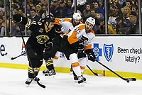 April 5, 2014: Philadelphia Flyers Zac Rinaldo (36) watches by Boston Bruins Gregory Campbell (11). The Boston Bruins defeated the Philadelphia Flyers 5-2 in a regular season NHL Eishockey Herren USA game at TD Garden in Boston, Massachusetts. NHL Eishockey Herren USA APR 05 Flyers at Bruins <br />