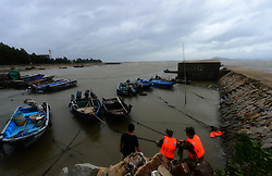 FUJIAN, Sept. 14, 2016 (Xinhua) -- Border guards help to anchor the fishing boats in Fuqing, southeast China's Fujian Province, Sept. 14, 2016. China's National Marine Environmental Forecasting Center (NMEFC) on Wednesday upgraded its warning for ocean waves triggered by Typhoon Meranti to ''red,'' the highest of a four-color warning system. (Xinhua/Wei Peiquan) (zyd) (Credit Image: © Wei Peiquan/Xinhua via ZUMA Wire)